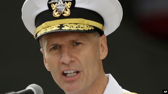 FILE - US Navy Vice Adm. Joseph Aucoin, commander of the 7th Fleet, delivers a speech in front of the nuclear-powered aircraft carrier USS Ronald Reagan in Yokosuka, Japan.