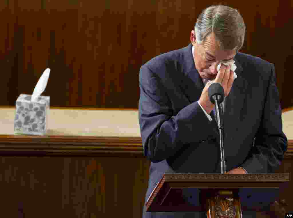 Outgoing Speaker of the House John Boehner, Republican of Ohio, wipes his eyes as he gives a farewell speech from the House floor at the U.S. Capitol in Washington, D.C. Paul Ryan, Republican of Wisconsin, becomes the new Speaker.