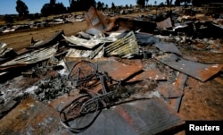 FILE - A bicycle lies amongst the debris of houses destroyed in post election violence in the village of Rukuini near Eldoret, northwest of Nairobi, Jan. 7, 2008.