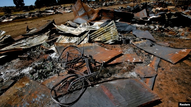 A bicycle lies amongst the debris of houses destroyed in post election violence in the village of Rukuini near Eldoret, northwest of Nairobi, Kenya, Jan. 7, 2008.