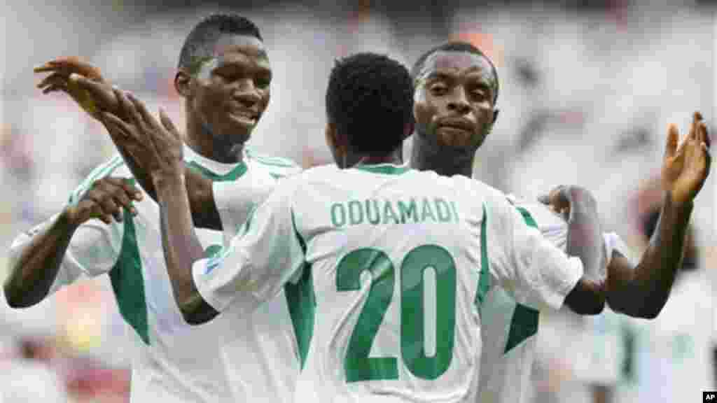 Nigeria's Nnamdi Oduamadi is celebrated after scoring his side's 3rd goal by Sunday Mba, right, and Kenneth Omeruo during the Confederations Cup match between Tahiti and Nigeria.