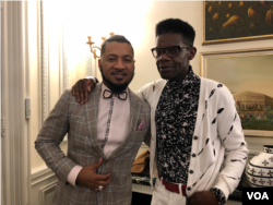 DC Fashion Week founder Ean Williams, left, with Haitian designer Victor Glemaud at the Haitian Embassy fashion event in Washington D.C., Feb. 23, 2018. (VOA / S. Lemaire)