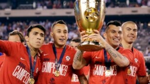 Chile's Edson Puch holds the championship trophy after the Copa America Centenario championship soccer match, Sunday, June 26, 2016.