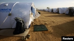 Malian refugee prays at UNHCR camp for civilians fleeing violence in Libya, near the border crossing of Ras Jdir, March 3, 2011.