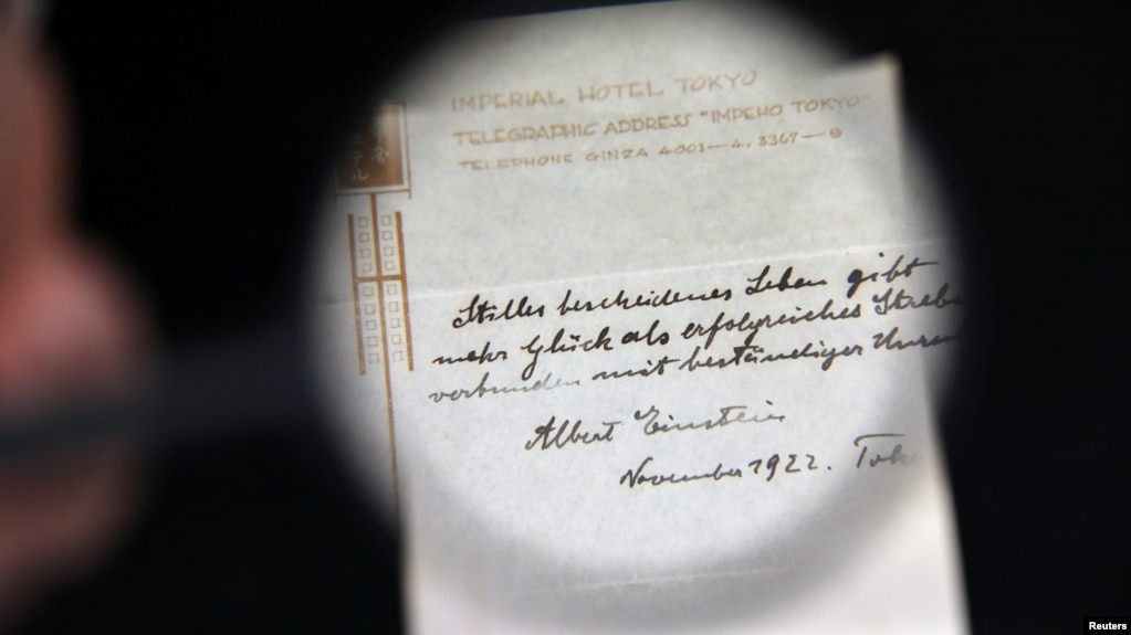 einstein s note on happiness sells for million a note written on a tokyo hotel official paper in 1922 by albert einstein is seen