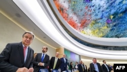 FILE - UN Secretary-General Antonio Guterres (L) looks on at the opening of the United Nations Human Rights Council, Feb. 27, 2017 in Geneva.