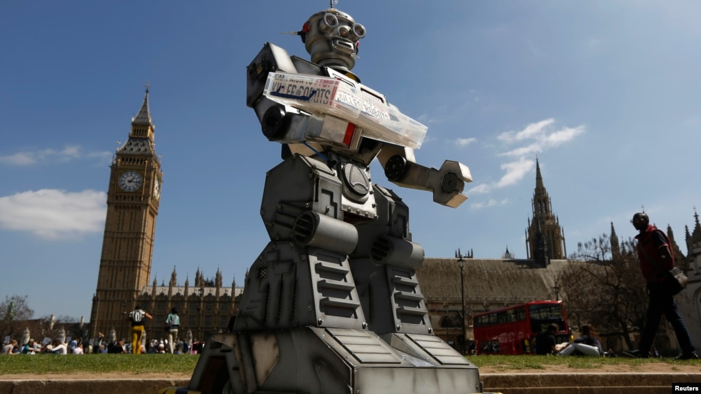 FILE - A mock killer robot is pictured in front of the Houses of Parliament and Westminster Abbey as part of the Campaign to Stop Killer Robots in London, April 23, 2013.