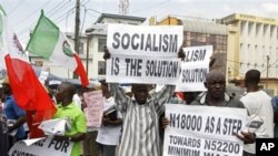 Trade union members display placards during a protest, in Lagos, Nigeria, Wednesday, Nov. 10, 2010. Trade unions protesting Nigeria's minimum wage have called a warning strike across the oil-rich nation. Wednesday's strike by the Nigerian Labor Congress a