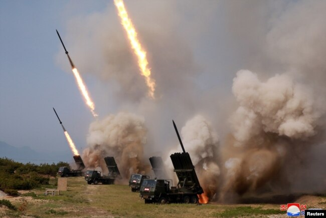 """North Korean military conducts a """"strike drill"""" for multiple launchers and tactical guided weapon into the East Sea during a military drill in North Korea, in this May 4, 2019, photo supplied by the Korean Central News Agency (KCNA)."""