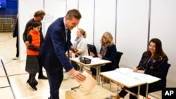 Independent Party candidate Bjarni Benediktsson casts his ballot at a polling station, in Gardabae, Iceland, Sept. 25, 2021. Icelanders were voting in a general election dominated by climate change.