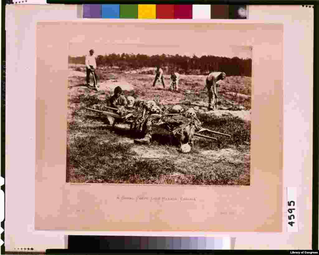 A burial party on the battle-field of Cold Harbor. (Photo by Alexander Gardner)