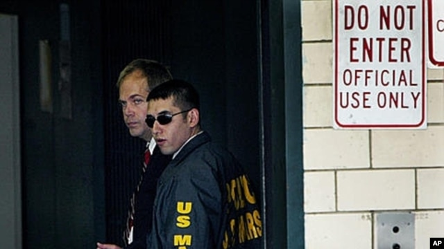 John Hinckley, left, at Federal Court in Washington, Sept. 2003 (file photo).