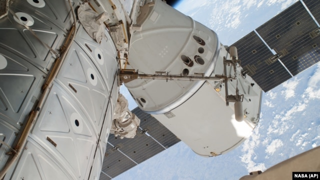 FILE - The SpaceX Dragon spacecraft is shown docked at the International Space Station.