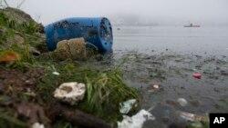 FILE - Trash litters Rodrigo de Freitas Lake in Rio de Janeiro, Brazil, Nov. 10, 2015.