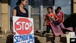 People participate in a protest against recent U.S. immigration policy that separates children from their families when they enter the United States as undocumented immigrants, in front of a Homeland Security facility in Elizabeth, New Jersey, June 17, 20