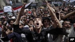 An anti-government protestor, center, reacts during a demonstration demanding the resignation of Yemeni President Ali Abdullah Saleh, in Sanaa, Yemen, March 6, 2011