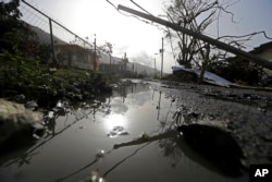 Downed power lines and debris are seen in the aftermath of Hurricane Maria in Yabucoa, Puerto Rico, Sept. 26, 2017.