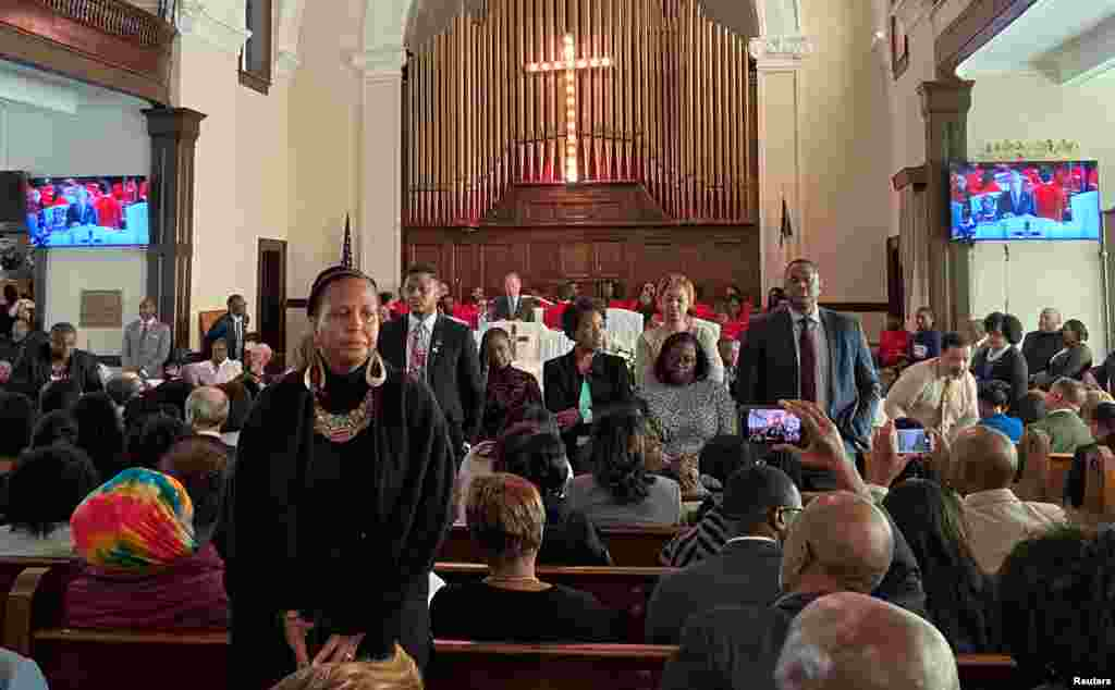 "Attendees turn their backs on Democratic U.S. presidential candidate Michael Bloomberg as he talks about his plans to help the black community during a commemoration ceremony for the 55th anniversary of the ""Bloody Sunday"" march in the Brown AME Church in Selma, Alabama, March 1, 2020."