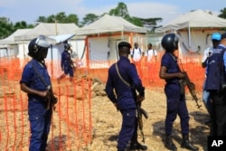 Policemen are on guard at a newly established Ebola reaction center in Beni, Democratic Republic of Congo, 10 August 2018.