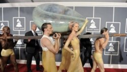 Lady Gaga arrives inside an egg at the Grammy Awards
