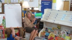 Teacher Laurie Gerard uses iPads with her kindergarten students in Auburn, Maine