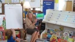 Teacher Laurie Gerard uses iPads with her kindergarten students in Auburn, Maine