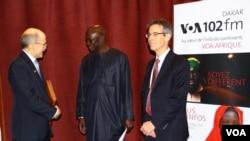VOA correspondent Idrissa Fall alongside U.S. Ambassador James P. Zumwalt and BBG Director of Strategy and Development Bruce Sherman.