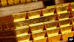 FILE - Gold bars are seen in London, Nov. 16, 2007.