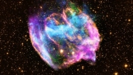 X-Ray, infrared and radio wave images of supernova remnant called W49B (X-ray: NASA/CXC/MIT/L.Lopez et al; Infrared: Palomar; Radio: NSF/NRAO/VLA)