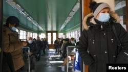People wear masks inside a vaporetto in Venice, Italy, March 15, 2021.