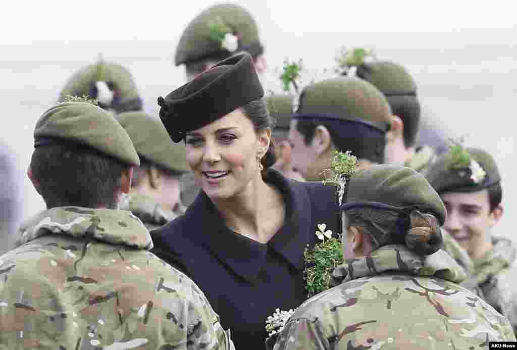 Britain's Kate, the Duchess of Cambridge meets cadets during a visit to the 1st Battalion Irish Guards at the St. Patrick's Day Parade at Mons Barracks, Aldershot, in England, March 17, 2015.