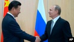 Си Цзиньпин и Владимир Путин. Уфа, Россия, 8 июля 2015.