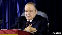 FILE - President Abdelaziz Bouteflika gestures during a swearing-in ceremony in Algiers, April 28, 2014.