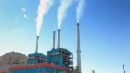 Smoke rises from power plant