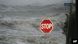 Isaac's winds and storm surge overcome a seawall and flood South Beach Boulevard, Waveland, Miss., Aug. 29, 2012.