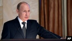 Russian President Vladimir Putin speaks before officials of the Federal Security Service in Moscow, March 26, 2015.