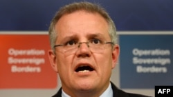 FILE - Australian Immigration Minister Scott Morrison speaks during a press conference in Sydney.