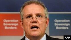 Chính sách được Bộ trưởng Di Trú Scott Morrison loan báo đã làm cho Úc trở thành nước giàu có đầu tiên trên thế giới áp dụng biện pháp đóng cửa di trú để ứng phó với vụ bộc phát dịch Ebola.
