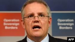 FILE - Australian Immigration Minister Scott Morrison speaks during a press conference in Sydney.