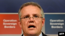 Bộ trưởng Bộ Di trú Australia Scott Morrison nói chuyện tai một cuộc họp báo ở Sydney