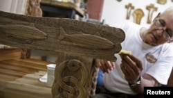 Bosnian wood carver-sculptor Salem Hajderovac works on a chair for Pope Francis, at his workshop in Zavidovici, Bosnia and Herzegovina, May 25,2015.