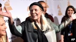 Joni Mitchell arrives at the 2015 Clive Davis Pre-Grammy Gala at the Beverly Hilton Hotel on Feb. 7, 2015, in Beverly Hills, Calif.