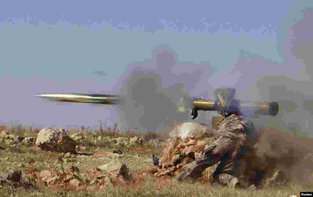 A Free Syrian Army fighter fires an anti-tank missile towards what the FSA said were locations controlled by forces loyal to Syria's President Bashar al-Assad in the eastern Hama countryside, Oct. 17, 2013.