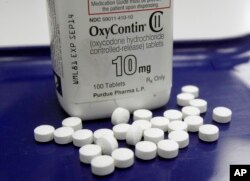 FILE - OxyContin pills, an opioid drug.