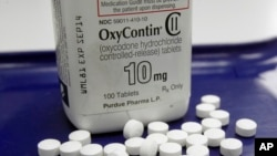 FILE - OxyContin, an opioid drug. Americans, even though comprising only five percent of the world's population, consume eighty percent of the its supply of pain medication