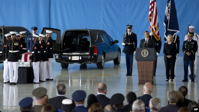 President Barack Obama, accompanied by Secretary of State Hillary Clinton, speaks during the Transfer of Remains Ceremony, September 14, 2012, at Andrews Air Force Base, Maryland.