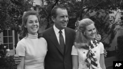 Richard Nixon with daughters