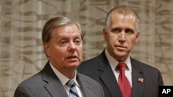 Sen. Lindsey Graham (R-SC), left, speaks to the media about national security as North Carolina Republican Sen. Thom Tillis, right, listens, in Greensboro, N.C., Sept. 26, 2014.
