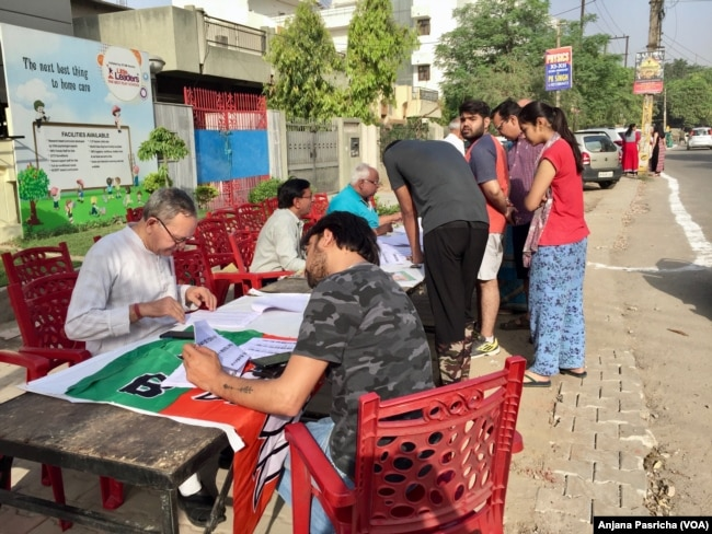 Some voters arrived early Thursday to search for their names on the electoral rolls and beat long lines.