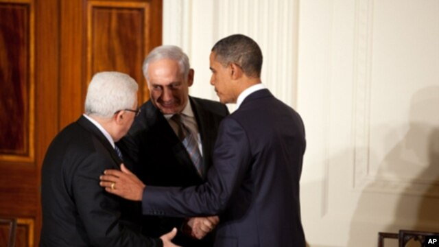 President Barack Obama talks with Palestinian President Mahmoud Abbas and Prime Minister Benjamin Netanyahu of Israel at the conclusion of a statement to the press in the East Room of the White House, Sept. 1, 2010.